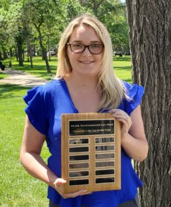 Haley Steran holding the moot award on behalf of her team-mates!